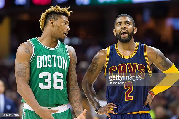 Marcus Smart of the Boston Celtics talks with Kyrie Irving of the Cleveland Cavaliers during the third quarter at Quicken Loans Arena on November 3...