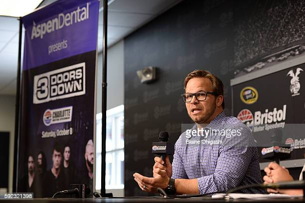 Marcus Smith CEO of Speedway Motorsports Inc and Ashley Montanaro Manager of Brand and Creative at Aspen Dental Management Inc speak in a press...