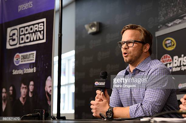 Marcus Smith CEO of Speedway Motorsports Inc speaks in a press conference during the NASCAR Sprint Cup Series Bass Pro Shops NRA Night Race at...
