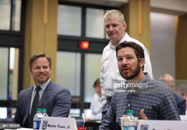Marcus Smith COO of Speedway Motorsports Jeff Burton and 2017 Monster Energy NASCAR Cup Series champion Martin Truex Jr watch on during the NACAR...