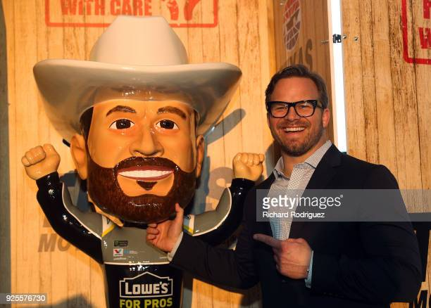 Marcus Smith COO of Speedway Motorsports poses with the Jimmie Johnson bobblehead that was unveiled during Media Day at Texas Motor Speedway on...