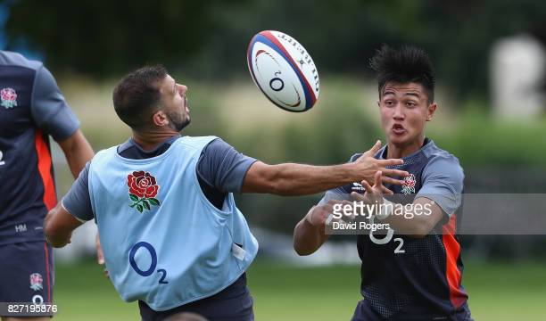 Marcus Smith is tackled by Danny Care during the England training session at the Lensbury Club on August 7 2017 in Teddington England