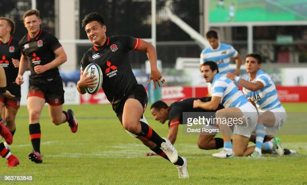 Marcus Smith of England breaks clear to score a second half try during the World Rugby U20 Championship match between England and Argentina at Stade...