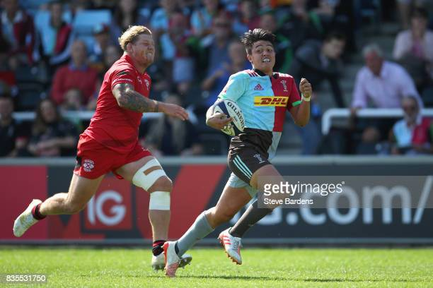 Marcus Smith of Harlequins breaks away to score a try during the pre season match between Harlequins and Jersey Reds at the Twickenham Stoop on...
