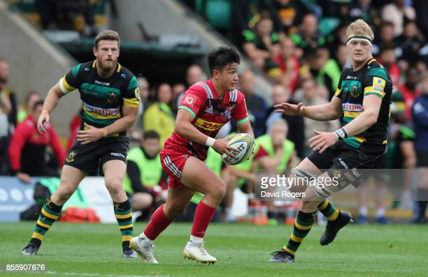 Marcus Smith of Harlequins breaks with the ball during the Aviva Premiership match between Northampton Saints and Harlequins at Franklin's Gardens on...