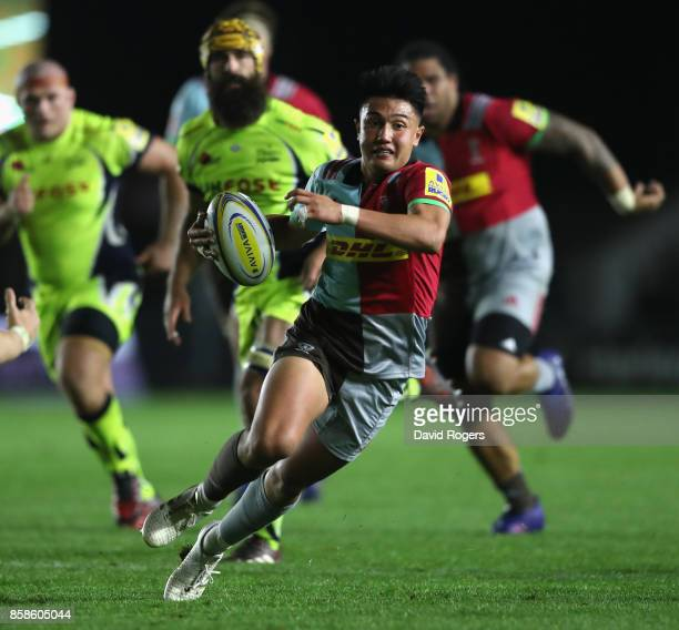 Marcus Smith of Harlequins breaks with the ball during the Aviva Premiership match between Harlequins and Sale Sharks Sharks at Twickenham Stoop on...