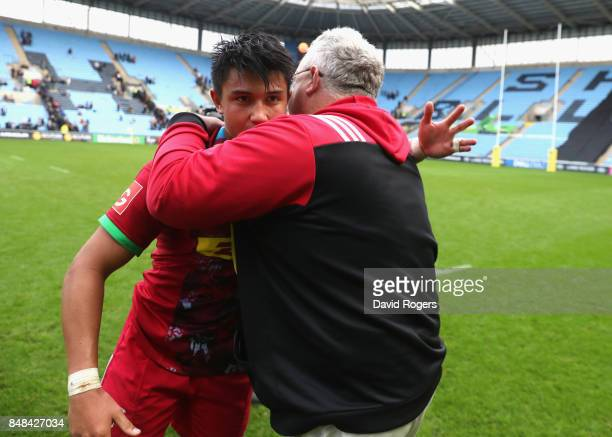 Marcus Smith of Harlequins celebrates with Harlequins director of rugby John Kingston after their victory during the Aviva Premiership match between...