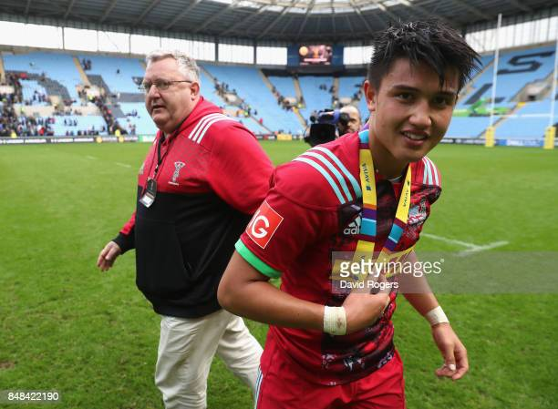 Marcus Smith of Harlequins celebrates with his man of the match medal watched by director of rugby John Kingston after their victory during the Aviva...