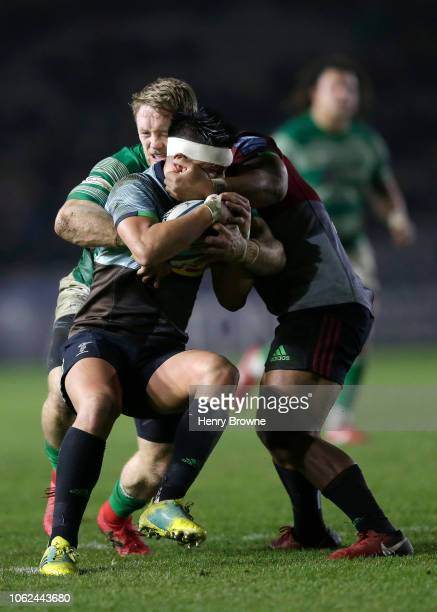 Marcus Smith of Harlequins ia tackled by Alex Tait of Newcastle Falcons during the Gallagher Premiership Rugby match between Harlequins and Newcastle...