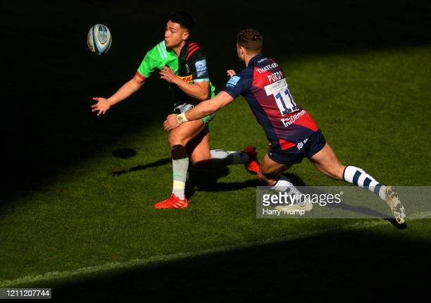 Marcus Smith of Harlequins is tackled by Henry Purdy of Bristol Bears during the Gallagher Premiership Rugby match between Bristol Bears and...