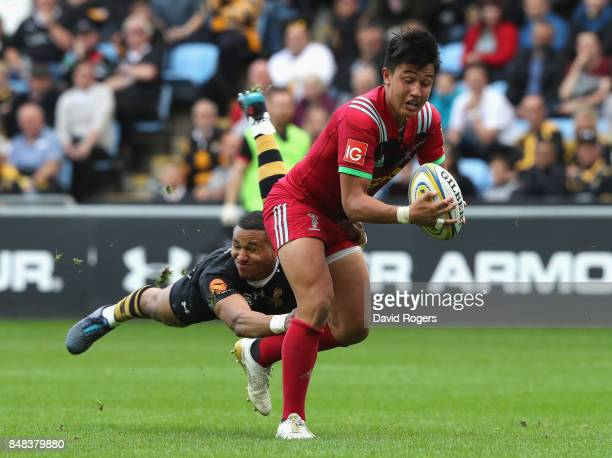 Marcus Smith of Harlequins is tackled by Marcus Waton during the Aviva Premiership match between Wasps and Harlequins at The Ricoh Arena on September...