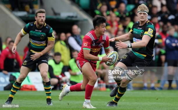 Marcus Smith of Harlequins moves past David Ribbans during the Aviva Premiership match between Northampton Saints and Harlequins at Franklin's...