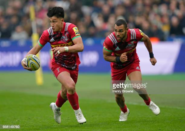 Marcus Smith of Harlequins runs with the ball during the Aviva Premiership match between Saracens and Harlequins at London Stadium on March 24 2018...