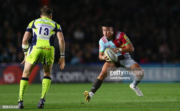 Marcus Smith of Harlequins takes on Mark Jennings of Sale Sharks during the Aviva Premiership match between Harlequins and Sale Sharks Sharks at...