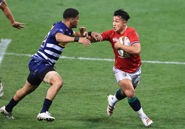 CAPE TOWN, SOUTH AFRICA - JULY 17: Marcus Smith of the British & Irish Lions is tackled by Abner van Reenen of DHL Stormers during the match between DHL Stormers and British & Irish Lions at Cape Town Stadium on July 17, 2021 in Cape Town, South Africa. (Photo by David Rogers/Getty Images)