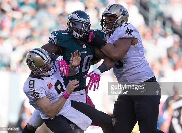 Marcus Smith of the Philadelphia Eagles knocks down Drew Brees of the New Orleans Saints as Andrus Peat of the New Orleans Saints attempts to block...