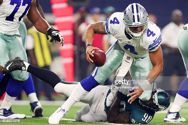 Marcus Smith of the Philadelphia Eagles sacks Dak Prescott of the Dallas Cowboys in the first quarter during a game between the Dallas Cowboys and...