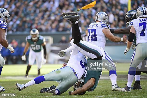 Marcus Smith of the Philadelphia Eagles sacks Mark Sanchez of the Dallas Cowboys as an offensive penalty is called during the second quarter at...