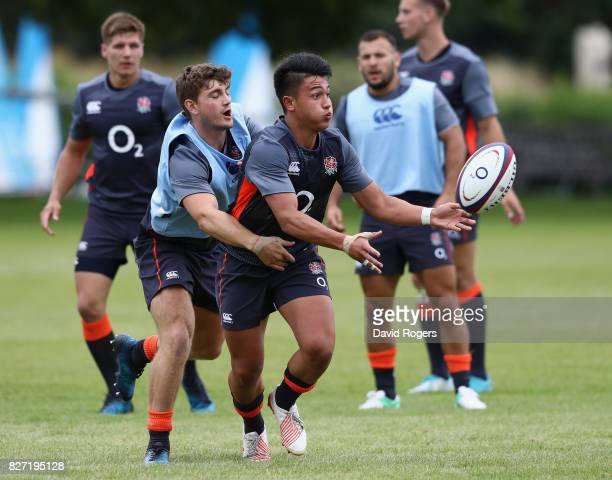 Marcus Smith passes the ball as Jack Maunder tackles during the England training session at the Lensbury Club on August 7 2017 in Teddington England