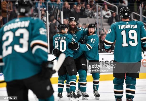 Marcus Sorensen, Brent Burns and Joakim Ryan of the San Jose Sharks celebrate a goal against the Minnesota Wild at SAP Center on November 6, 2018 in...