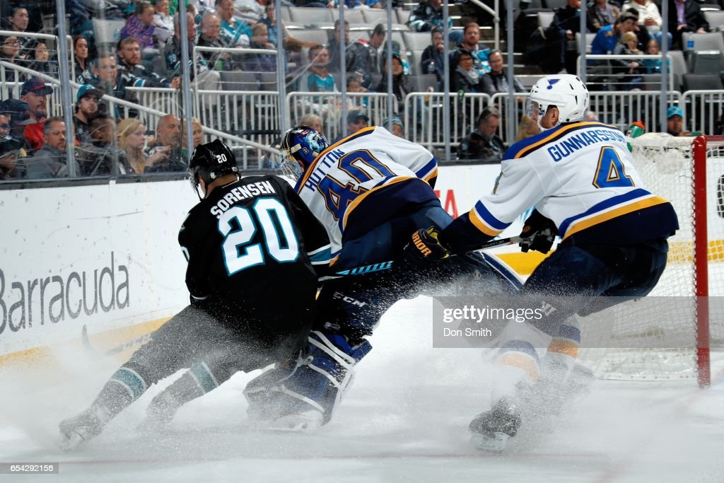 Marcus Sorensen #20 of the San Jose Sharks and Carter Hutton #40 of the St. Louis Blues battle for the puck while Carl Gunnarsson #4 of the St. Louis Blues defends at SAP Center at San Jose on March 16, 2017 in San Jose, California.