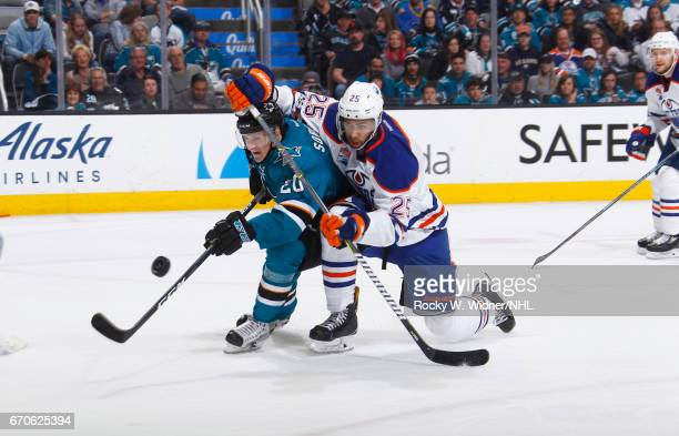 Marcus Sorensen of the San Jose Sharks and Darnell Nurse of the Edmonton Oilers skate after the puck in Game Four of the Western Conference First...