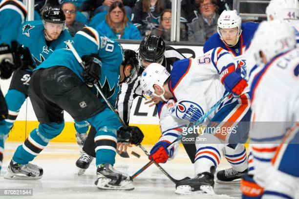 Marcus Sorensen of the San Jose Sharks and Mark Letestu of the Edmonton Oilers face off in Game Three of the Western Conference First Round during...