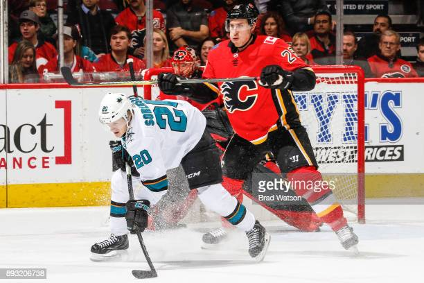Marcus Sorensen of the San Jose Sharks and Michael Stone of the Calgary Flames battle for position in a game against the San Jose Sharks at the...