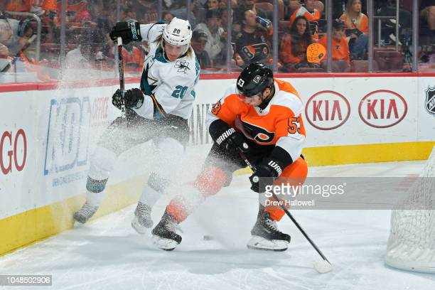 Marcus Sorensen of the San Jose Sharks and Shayne Gostisbehere of the Philadelphia Flyers battle for control of the puck at the Wells Fargo Center on...