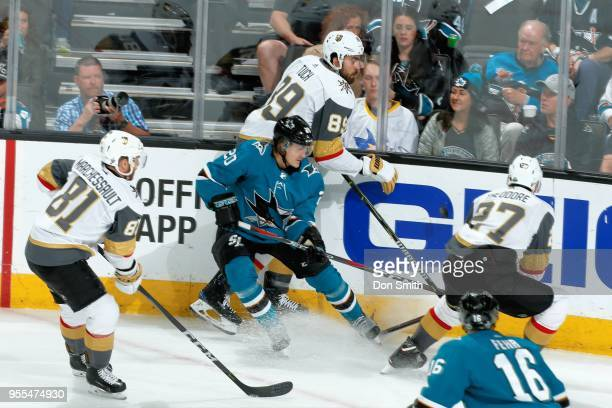 Marcus Sorensen of the San Jose Sharks battles with Jonathan Marchessault Alex Tuch and Shea Theodore of the Vegas Golden Knights for the puck in...