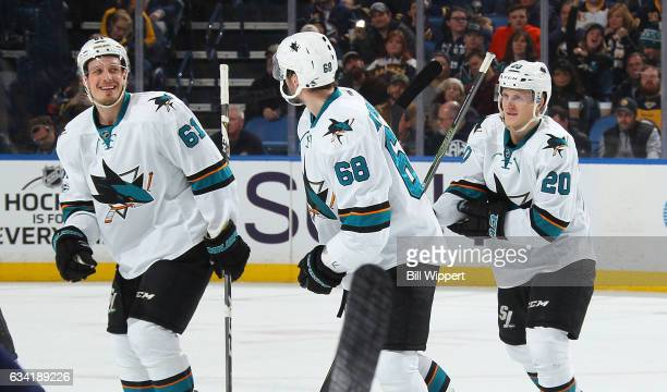 Marcus Sorensen of the San Jose Sharks celebrates his first NHL point off a goal by Melker Karlsson during an NHL game at the KeyBank Center on...