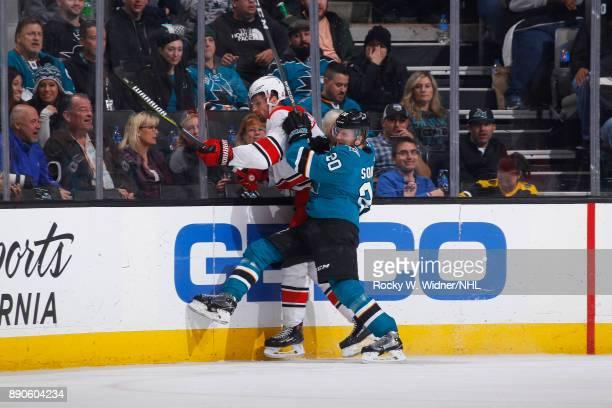 Marcus Sorensen of the San Jose Sharks collides with the Carolina Hurricanes at SAP Center on December 7 2017 in San Jose California
