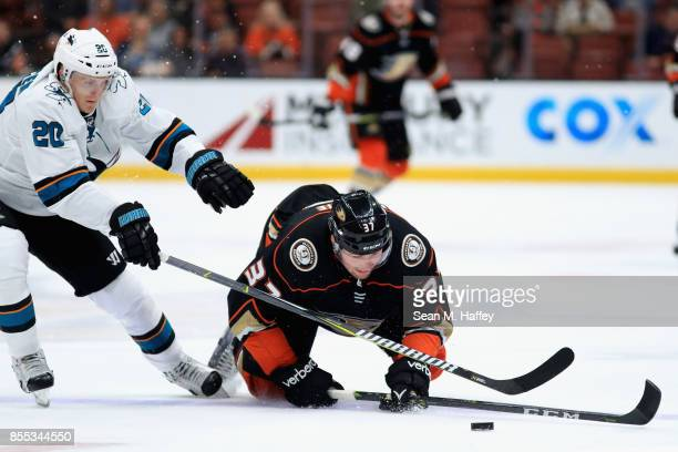 Marcus Sorensen of the San Jose Sharks defends against Nick Ritchie of the Anaheim Ducks during the third period of a preseason game at Honda Center...