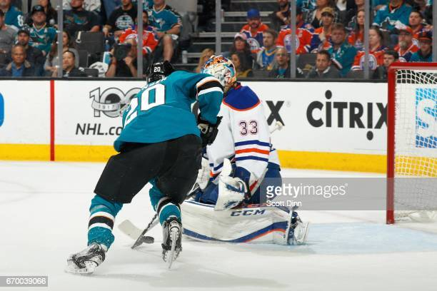 Marcus Sorensen of the San Jose Sharks gets the puck by Cam Talbot of the Edmonton Oilers to make a second period goal in Game Four of the Western...