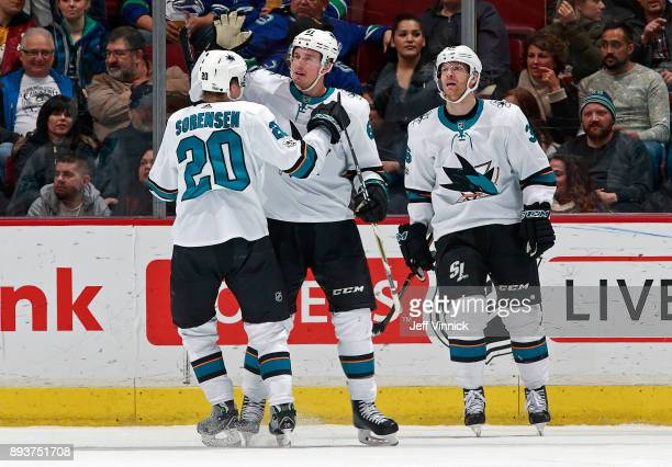 Marcus Sorensen of the San Jose Sharks is congratulated by teammate Justin Braun after scoring during their NHL game against the Vancouver Canucks at...