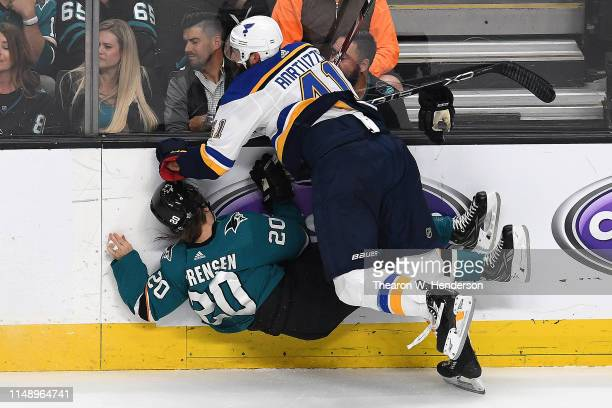 Marcus Sorensen of the San Jose Sharks is hit by Robert Bortuzzo of the St Louis Blues in Game Two of the Western Conference Final during the 2019...
