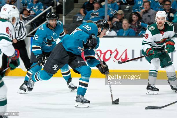 Marcus Sorensen of the San Jose Sharks shoots the puck as Joel Ward of the San Jose Sharks and Nate Prosser of the Minnesota Wild look at SAP Center...
