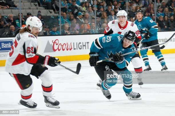 Marcus Sorensen of the San Jose Sharks skates against Erik Karlsson of the Ottawa Senators at SAP Center on December 9 2017 in San Jose California