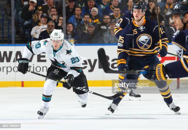 Marcus Sorensen of the San Jose Sharks skates against Jack Eichel of the Buffalo Sabres in his first NHL game at the KeyBank Center on February 7...