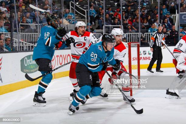 Marcus Sorensen of the San Jose Sharks skates against Klas Dahlbeck of the Carolina Hurricanes at SAP Center on December 7 2017 in San Jose California