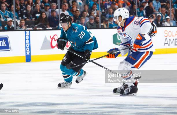 Marcus Sorensen of the San Jose Sharks skates against Matthew Benning of the Edmonton Oilers in Game Six of the Western Conference First Round during...