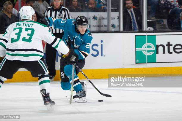 Marcus Sorensen of the San Jose Sharks skates with the puck against Marc Methot of the Dallas Stars at SAP Center on February 18 2018 in San Jose...