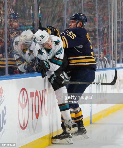 Marcus Sorensen of the San Jose Sharks skating in his first shift of an NHL game is checked by Rasmus Ristolainen of the Buffalo Sabres at the...