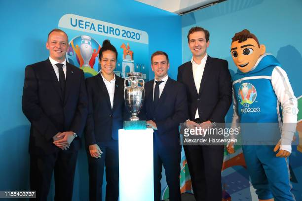 Marcus Stenger Philipp Lahm Celia Sasic Friedrich Curtius and Skillzy pose with the EURO Championships Winner trophy at the EUROCountdown 2020 One...