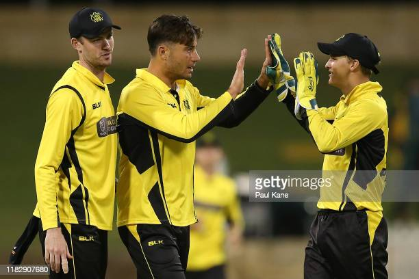 Marcus Stoinis and Josh Philippe of Western Australia celebrate the wicket of Will Sutherland of Victoria during the Marsh One Day Cup match between...