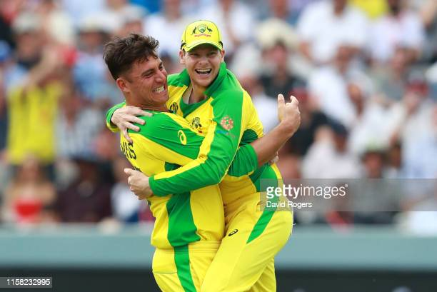 Marcus Stoinis celebrates with team mate Steve Smith after taking the wicket of Jos Buttler during the Group Stage match of the ICC Cricket World Cup...