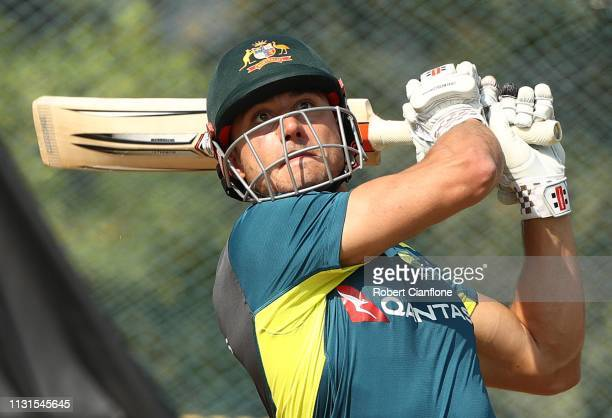 Marcus Stoinis of Australia bats during the Australian practice session at ACAVDCA Stadium ahead of game one in the T20I Series between India and...