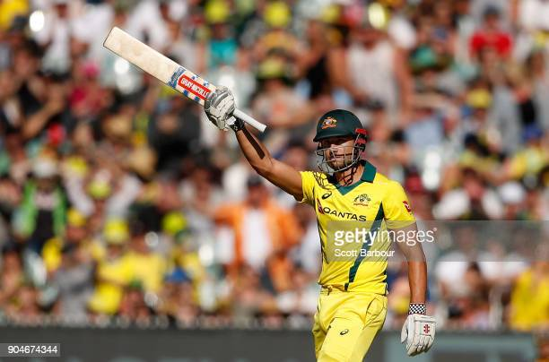 Marcus Stoinis of Australia celebrates his half century during game one of the One Day International Series between Australia and England at...