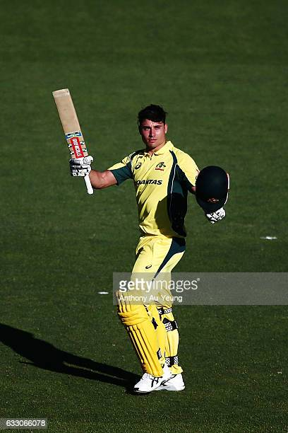 Marcus Stoinis of Australia celebrates scoring a century during the first One Day International game between New Zealand and Australia at Eden Park...