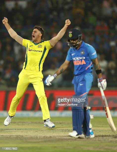 Marcus Stoinis of Australia celebrates taking the wicket of Virat Kohli of India during game five of the One Day International series between India...